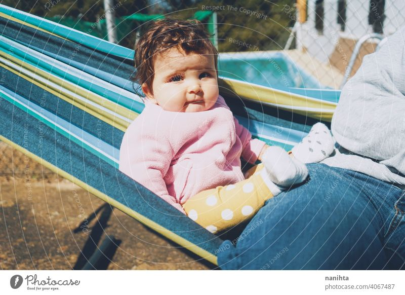 Little baby having fun on a hammock in a sunny day happy holidays lifestyle family babyhood child kid girl cute lovely time enjoy happiness leisure freedom
