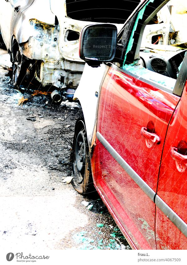 Torched car Car Street Transport Burnt out Fire Total loss Roadside Town Water for firefighting Wrecked car