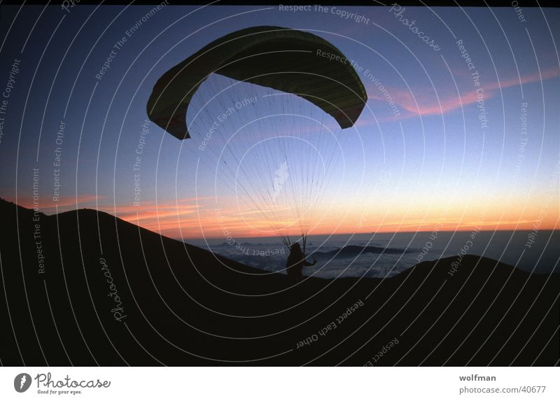 sillouette Paragliding Sunset Hawaii Night Extreme sports paraglider Mauna Kea first flight dawn wolfman wk@weshotu.com