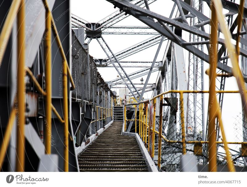 F60 Passageway colliery open pit mining Metal Scaffolding Iron reeds lines align Yellow Gray Corridor off Tall Depth of field Aspire Architecture Safety