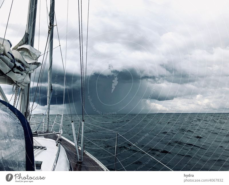 Sailing into a thunderstorm on the open sea - there is a lot of rain Sailboat yacht Yacht Ocean Baltic Sea Clouds downpour Storm clouds Thunder and lightning
