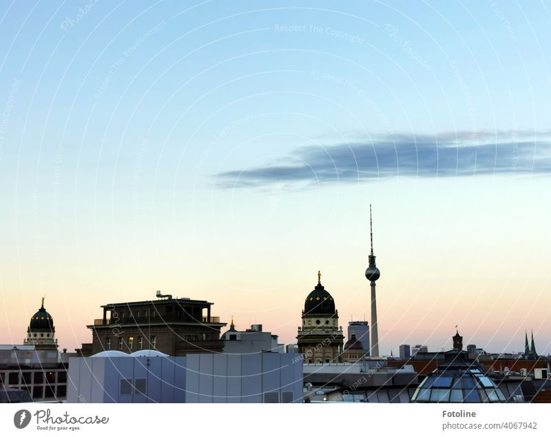 Berlin in the beginning sunset from above with view in the direction of the television tower. Television tower Berlin TV Tower Alexanderplatz Landmark Sky