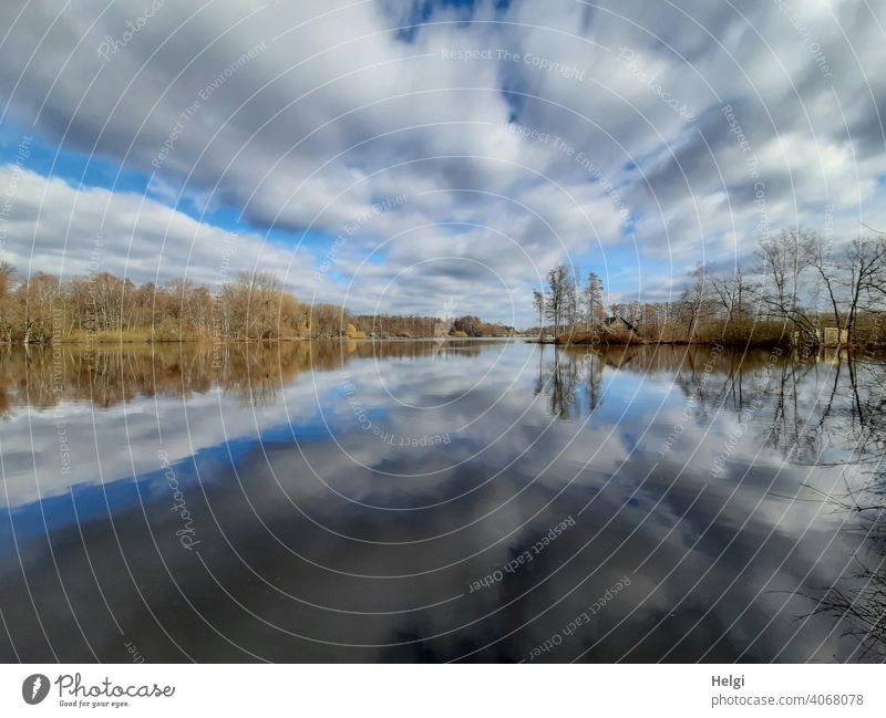 Cloud drama and lakeside with reflection in moor lake Lake Moor lake Hücker Moor Sky Clouds Dramatic art Lakeside trees Hut Nature Landscape Wide angle Water