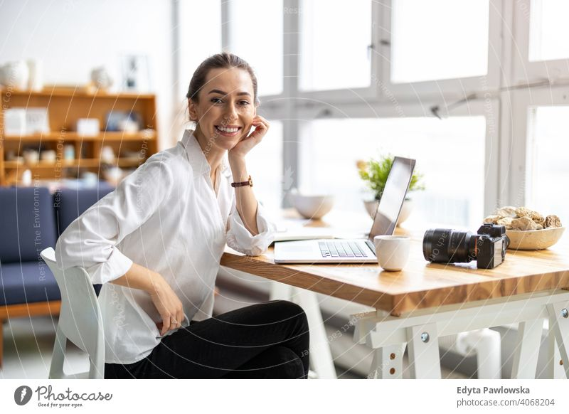 Young female freelancer working in loft office millennials student hipster indoors window natural girl adult one attractive successful people confident person