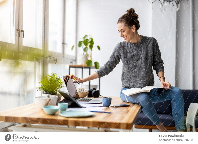 Young adult female professional working in a modern office millennials student hipster indoors loft window natural girl one attractive successful people