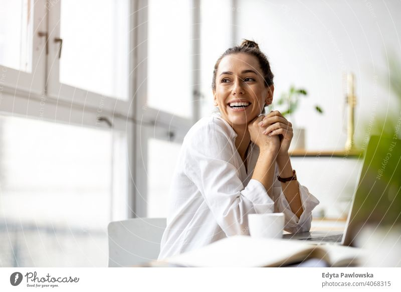 Young woman working in creative start-up company millennials student hipster indoors loft window natural girl adult one attractive successful people confident