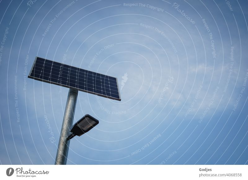 Solar powered street lighting in front of neutral blue sky with veil clouds| Climate - compliant streetlamp Solar system solar powered Sky Lamp Street lighting