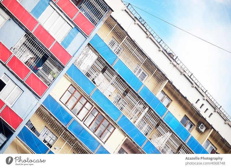 Tilted image of a building with colorful balconies. angle angle perspective angle view apartment architecture balcony block blue city cityscape contemporary