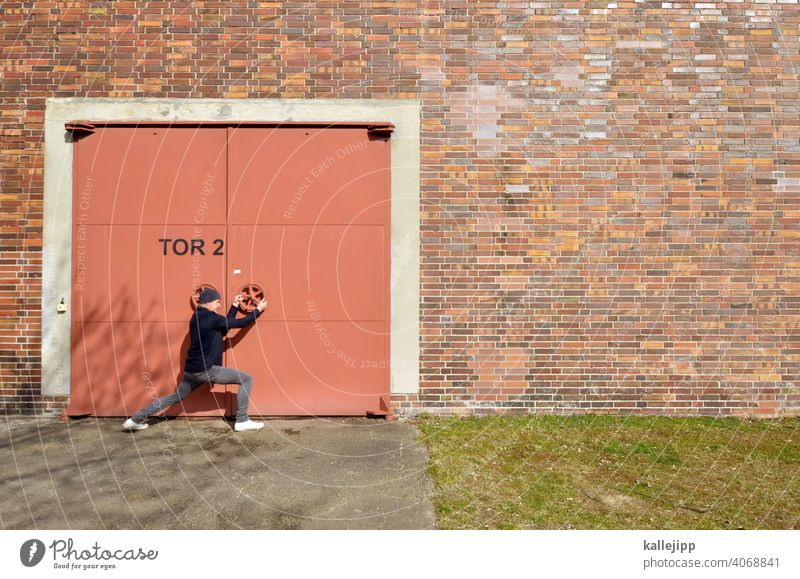 zonck Goal door Door handle Rotate open Close Lock Entrance Old Closed Colour photo Man Human being Iron gate Warehouse Economy closed door lockdown Opening
