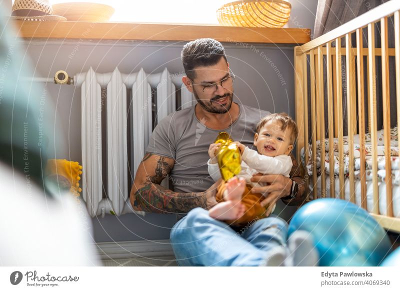 Father playing with his little son at home single parent single dad fathers day fatherhood stay at home dad paternity leave modern manhood family child house