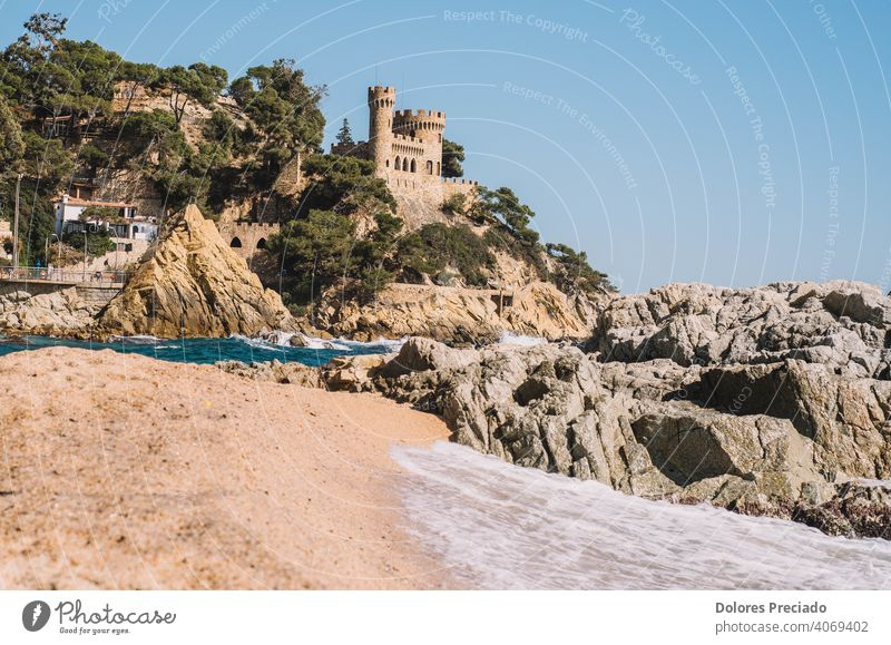 Mediterranean landscape on the Spanish costa brava of a beach with a medieval castle sea skyline nature water tourism relax environment calm vacation seascape