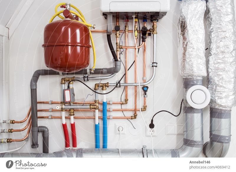 Heating installation and central boiler heating system on wall in house close-up water plumbing plumber repair service home man worker fix installing