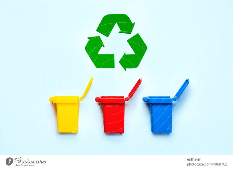 Yellow, red and blue recycle bins with recycle symbol. Recycling concept recycling bottle environment save arrangement green materials environmental