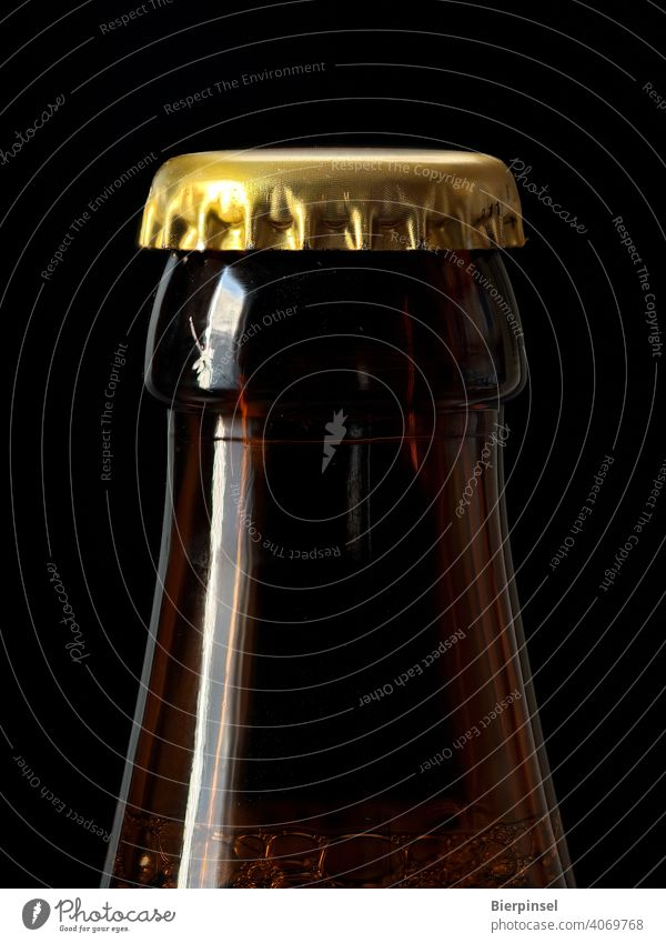 Beer bottle closed with a crown cork Crown cap Crown cork Bottle locked Closure Prongs Tin Glass golden Brown Beverage Drinking close-up unopened Airtight Blow