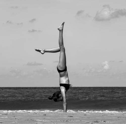 young girl does perfect handstand on beach Beach Handstand Girl Athletic athletic Joy Fitness Sports Exterior shot Lifestyle Sports Training Healthy workout