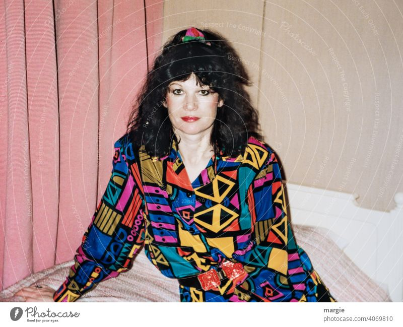 A young woman sits on a bed and looks into the camera Woman Young woman variegated Blouse Dark-haired Drape Photography Analog analogue photography Paper Curl