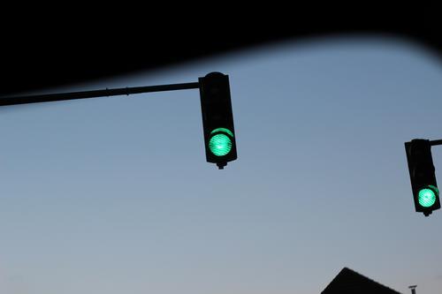 Green light - two green lights Traffic light Light Transport Road sign Exterior shot Colour photo Road traffic Traffic infrastructure Town Motoring Twilight