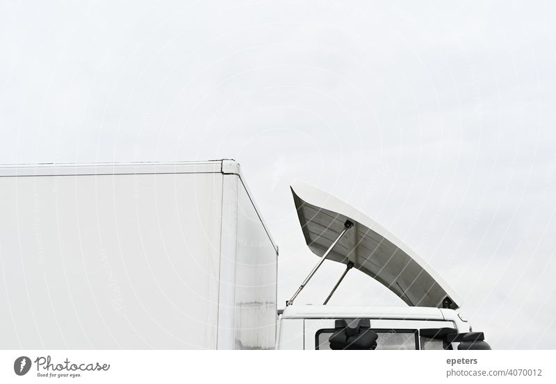 Roof of a white truck against an overcast sky automobile Large blurriness Cargo Commerce Copy Space Delivery E-commerce e-commerce cargo Heavy Highway Industry