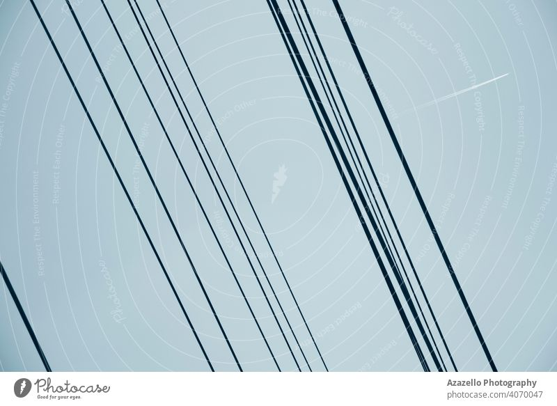 Electricity wires view against the sky abstract architecture background blue cable danger design detail distribution electric electrical electricity energy grid
