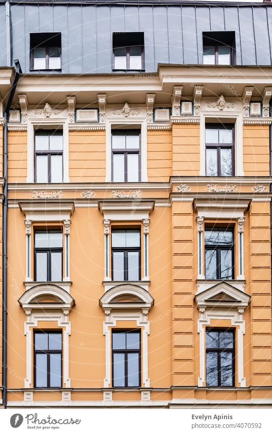Orange brick art nouveau building façade with nine cream windows in Riga, Latvia, Europe art-nouveau baltic architecture facade latvia riga house old city