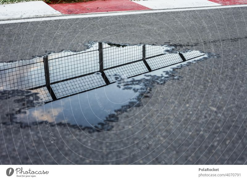 #A0# Curve with pitfalls curvaceous racetrack Running Asphalt Speed Puddle reflection Street Driving Exterior shot Colour photo Transport Motoring Road traffic
