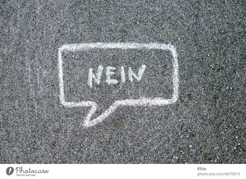 Speech bubble in which is written No no Cancelation communication say no Reject negate Characters authored Chalk Ground Street protest Discontent Word writing