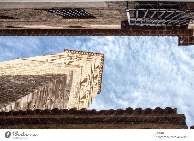 building construction. Tower Architecture Sky Clouds Blue Tall Exterior shot Manmade structures Building Deserted house wall Colour photo Day quadrangular