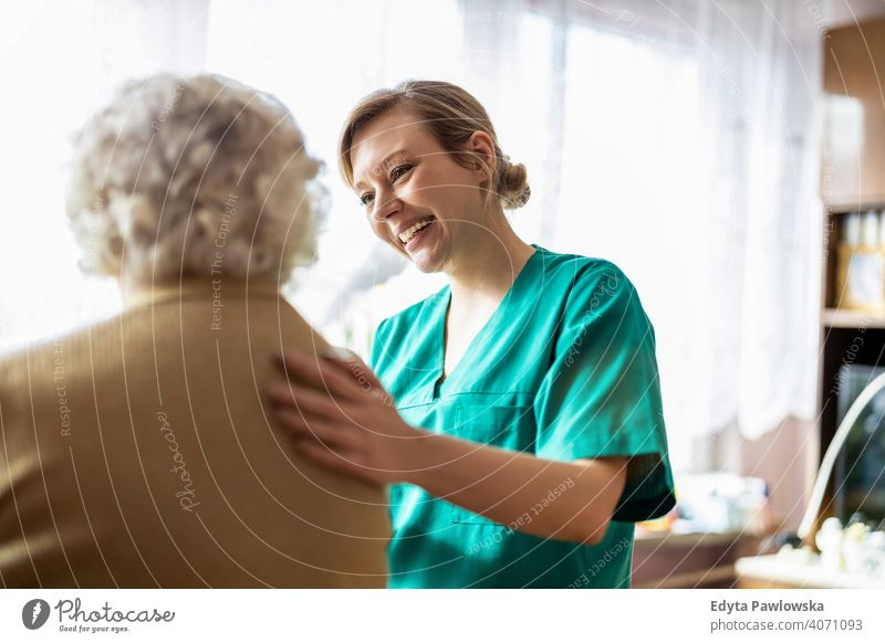 Healthcare worker at home visit real people candid genuine woman senior mature female Caucasian elderly house old aging domestic life grandmother pensioner