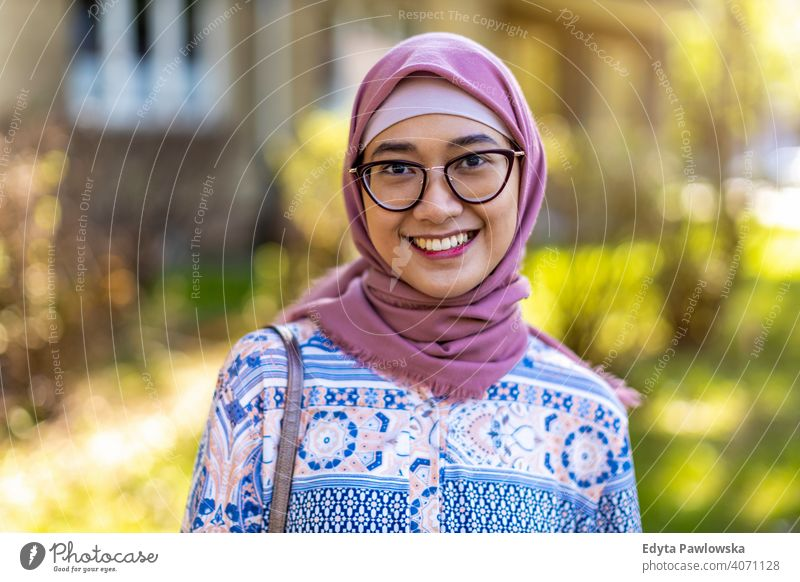 Smiling young woman wearing hijab outdoors headscarf muslim islam arabic summer girl people young adult female lifestyle active millennial outside attractive