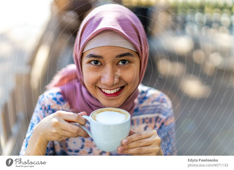 Happy Young Muslim Woman Drinking Coffee hijab headscarf muslim islam arabic woman summer girl people young adult female lifestyle active outdoors millennial