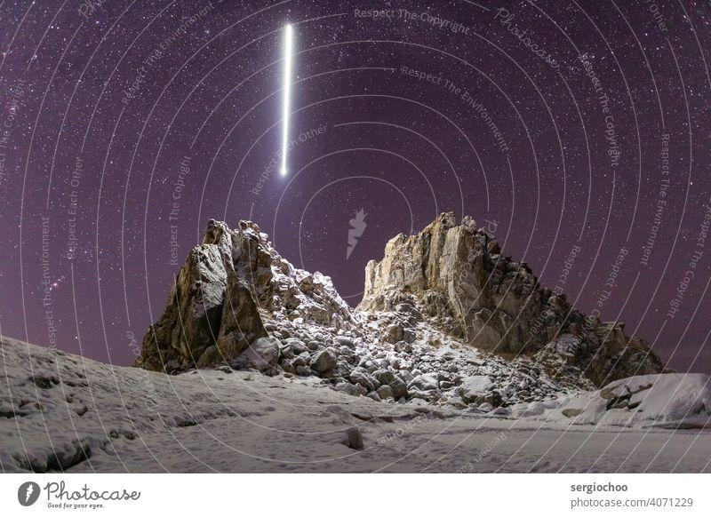 Ray shines upon the Shamanka rock on the lake Baikal stargazing Stars Night Night sky UFO ufoland landing site UFO lamp Milky way Rock Lake Central perspective