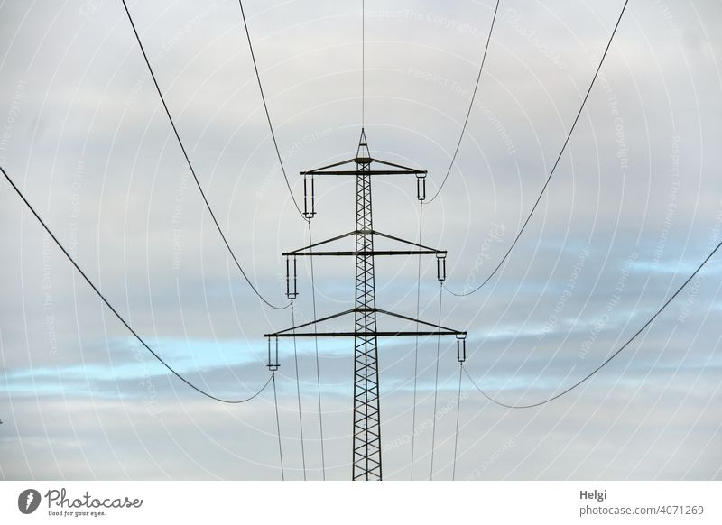 Power pole with high voltage lines in front of cloudy sky II Electricity pylon Power lines Energy High voltage power line Energy industry Technology