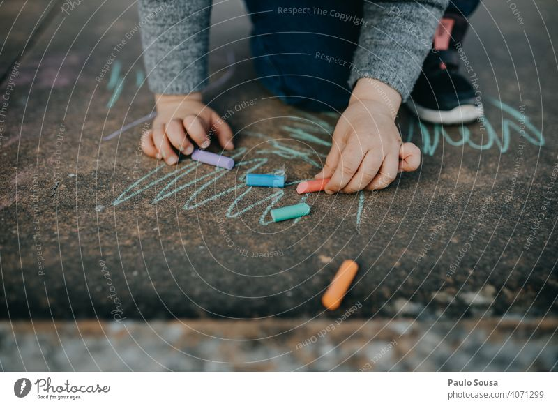 Child drawing with colored chalk on the floor Draw Drawing Chalk Street painting Chalk drawing Playing Infancy Creativity Painting (action, artwork) Art