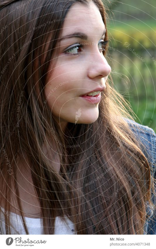 View to the side portrait Long-haired naturally Hair and hairstyles Brunette Feminine Face 18 - 30 years pretty Facial expression Face of a woman Emotions