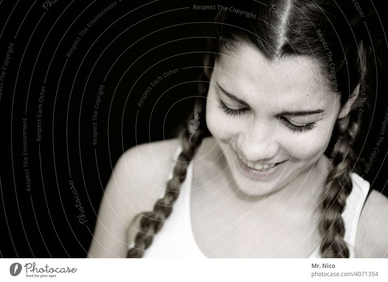 young woman with braided pigtails looks down portrait Head Woman Face Shoulder Feminine Esthetic Longing naturally Emotions Cool (slang) pretty good-looking