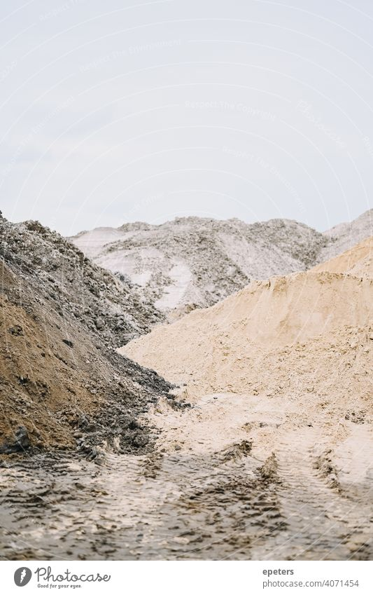 Pile of sand on a construction site on a cloudy day background Construction Copy Space Detail Geology Gravel Grit Heap Industrial industrial background Industry