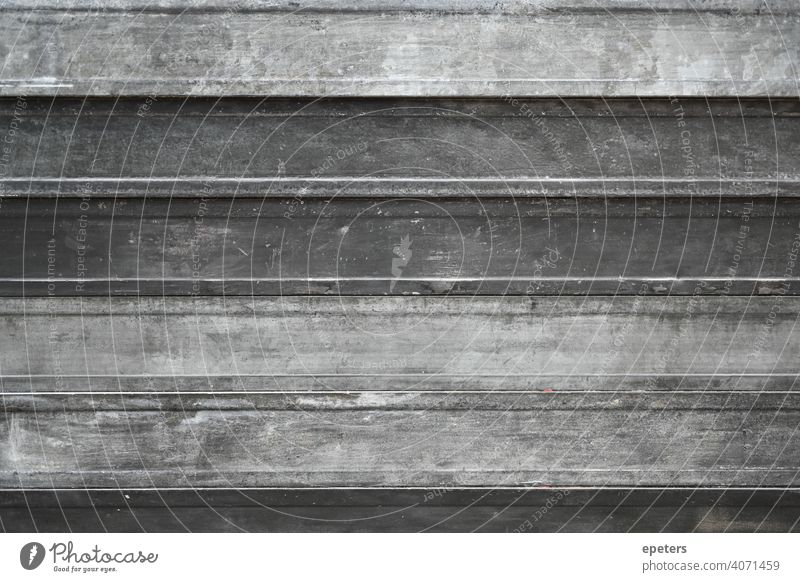 A stack of metal racks at a construction site aluminium background bar carbon closeup copy space dirty engineering factory gray grey heavy heavy duty industrial