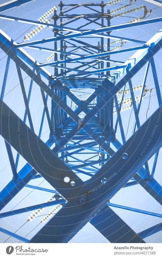 Eectricity pylon bottom view. inside blue business cable civilization current danger design distribution ecology electric electrical electricity energy