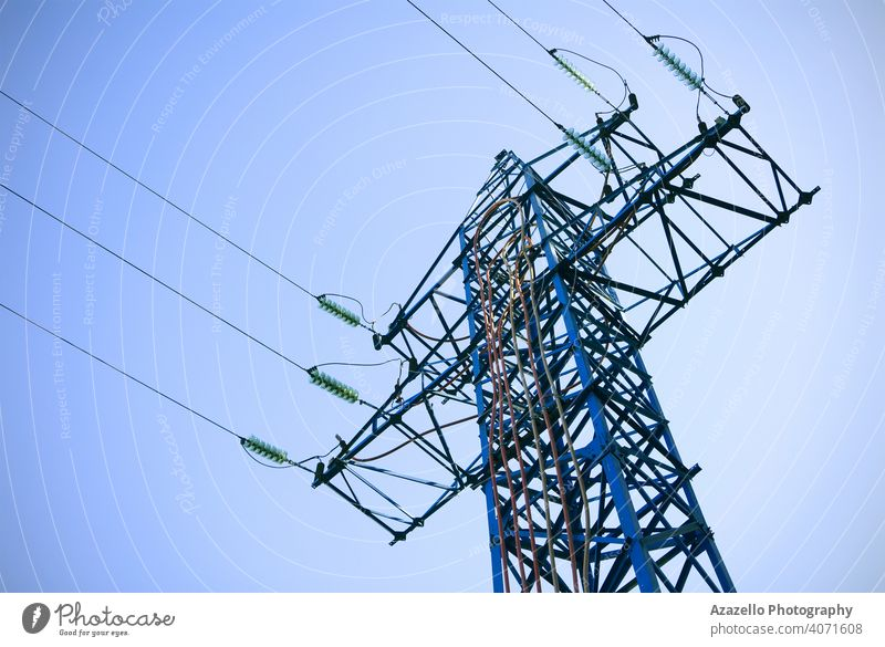 Bottom view of an electricity pylon. blue business cable civilization current danger design distribution ecology electrical energy engineering environment