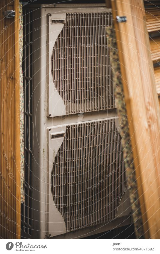 Air-source heat pump on a single-family house - clad in wood - open here | ecological, sustainable, modern and environmentally friendly heating system