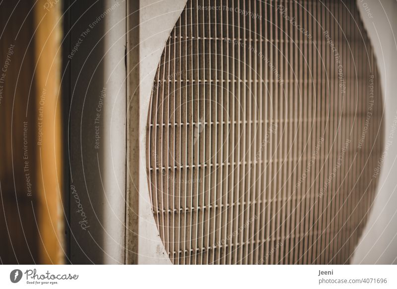 Fan of an air heat pump - side view | ecological, sustainable, modern and environmentally friendly heating system Air source heat pump Modern Sustainability