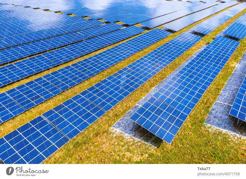 a modern solar park from above solar cells sun sunny winter energy green energy sun energy clouds modern solar cells blue blue solar cells