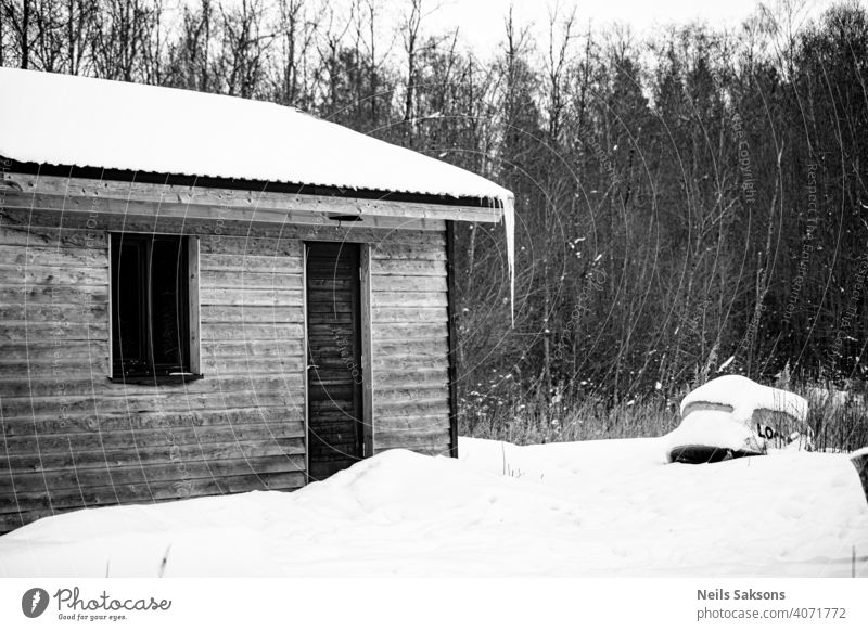 old wooden fishing shack with big icicle, boat near it. winter landscape Abandoned aged agriculture architecture Baltic barn blue building cabin Christmas cold
