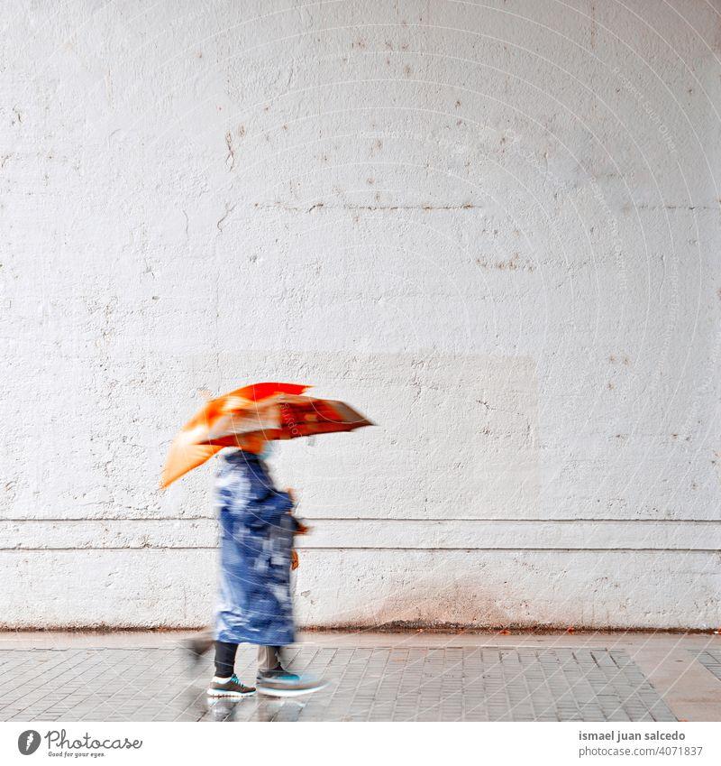 women with an umbrella in rainy days in spring season, Bilbao, Spain people person raining water human pedestrian street city urban bilbao spain walking