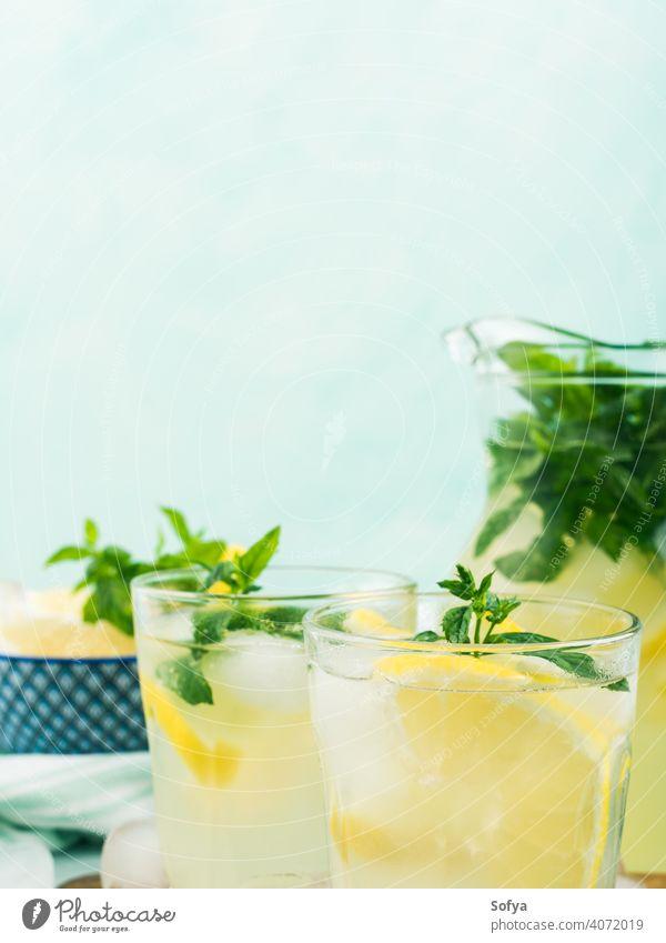 Fresh lemon lemonade in jug and glasses summer infused drink cocktail fruit leaf frozen italian spring juice citrus beverage food vintage mint gin vodka