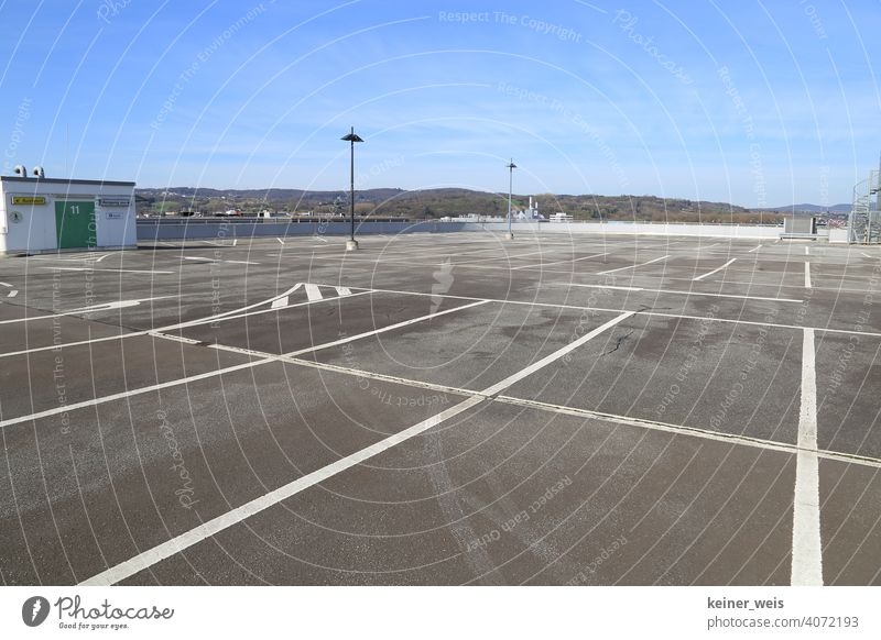 Empty parking spaces on a car park roof Closed too shutdown output lock coronavirus pandemic prevention broke nobody Deserted Markings Pitches lanterns