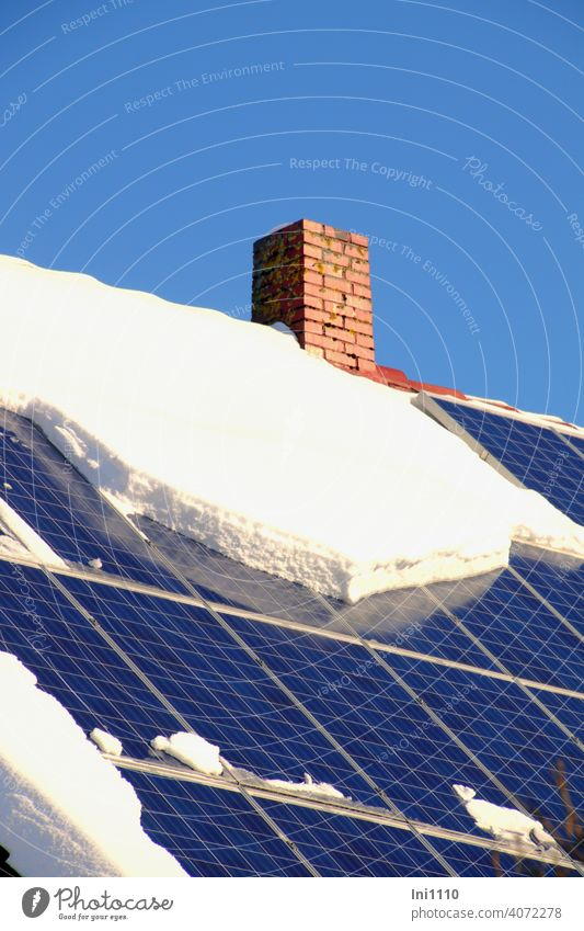 Photovoltaic system on the roof of a residential building partially covered with snow Solar Energy roof area Apartment Building photovoltaic system power supply