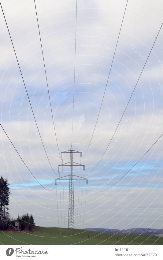 under high voltage lines with view to the power pole and into the landscape Electricity pylon Energy industry energy supply transport route Cables Overhead line