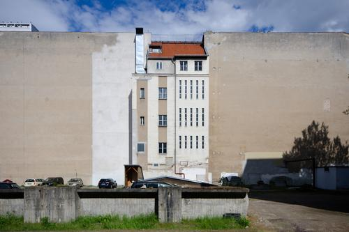 Central in the middle Town house (City: Block of flats) Fire wall Facade Ventilation shaft Backyard Old Downtown Berlin Sky Symmetry Historic Change