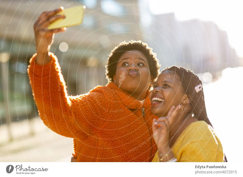 Beautiful happy girlfriends taking a selfie together diversity diverse people love outdoors day positivity confident carefree woman young adult casual beautiful